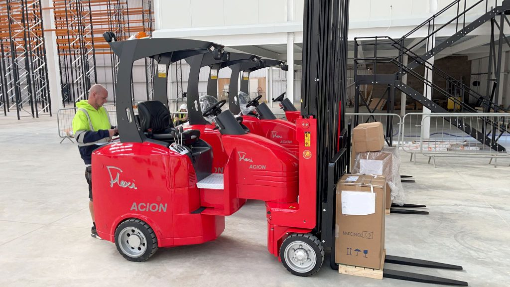 warehouse flexi trucks lined up after delivery